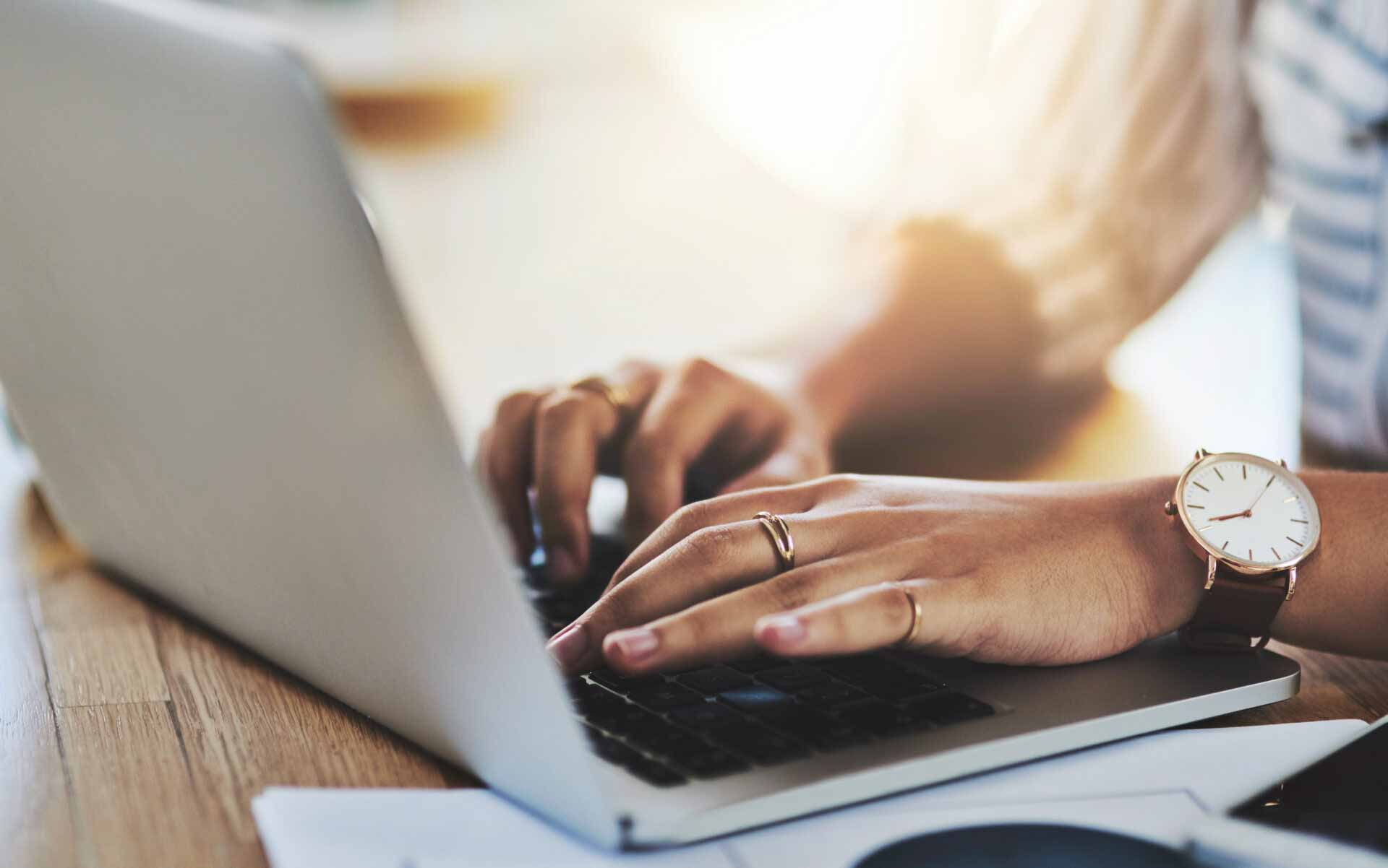 woman on computer for blog about building a successful website